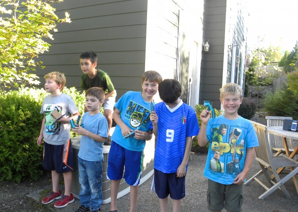 "Each boy had a pick axe. The game consisted of each one taking turns to ""mine"" in the backyard and find 1 treasure chest."