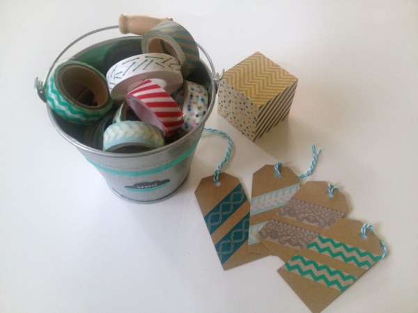 I store my stash of washi tape in small buckets. I've seen it displayed in a dessert plate. Take a look at my pin here.