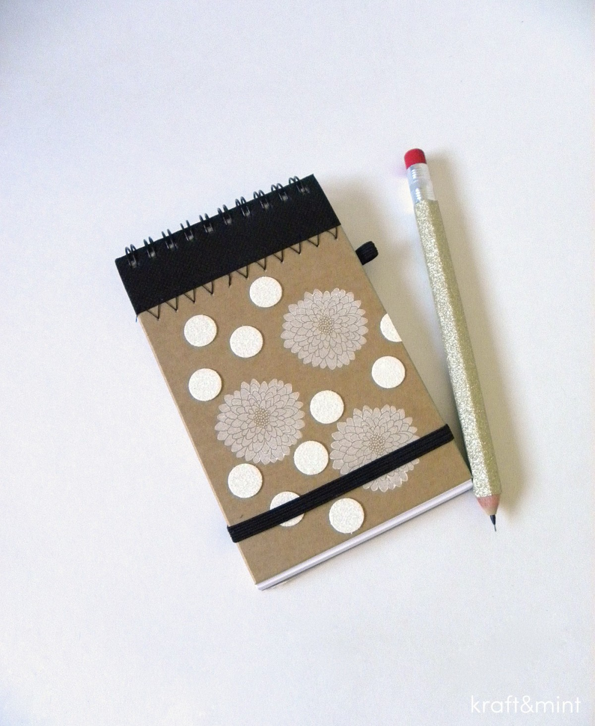 Notebook and mechanical pencil covered with gold sparkle tape.