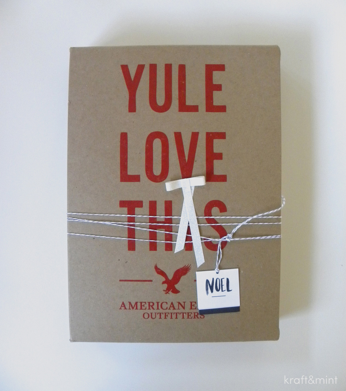 Box from American Eagle store. I loved it so I left it as is and added a bow made out of sparkly tape, twine and a different tag from the same designer mentioned above.